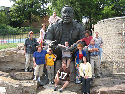 Participants from the 2004 NEH Teacher Summer Institute on the Geography of the American South pose at the Alex Haley statue in Knoxville.